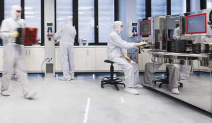 Workers working inside of a cleanroom environment