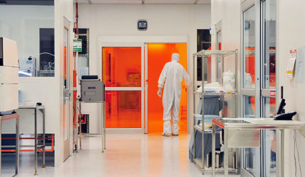 Man in white hazad suit carrying out cleanroom testing