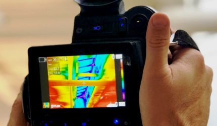 thermal imaging camera undertaking a thermal survey to a commercial building